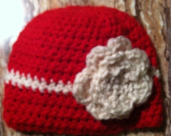 beanie hat with attached flower