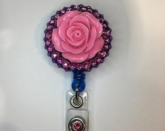 pink rose on blue