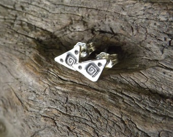 Handmade Triangle Stud Earrings, Sterling Silver Stamped Studs, Modern Spiral Post Earrings on Etsy by Mary-anne Fountain.