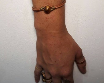 Stone Bracelet made with bronze,  leather, and various healing stones