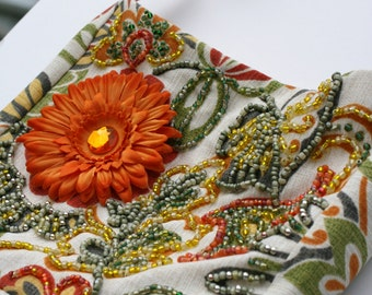Floral hand beaded purse, beige cotton upholstery fabric with orange flower with hand beaded front design.