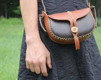 hand made leather purse. small leather bag. the wren in light and dark brown vegetable tanned leather. wood button. in stock. READY TO SHIP.