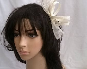 Ivory Sinamay and  Feather Fascinator with bow and loops..on a comb