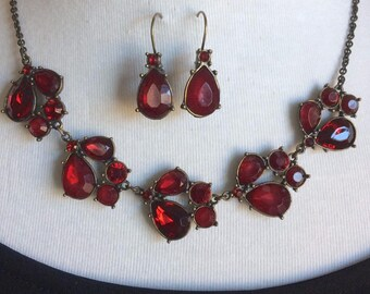 Vintage blood red glass necklace and earring set.