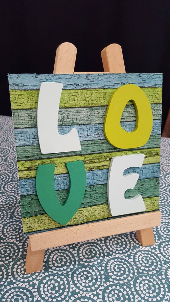 Square frame LOVE wooden letters decorated with