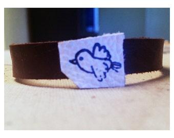 Leather wrist cuff with blue bird print