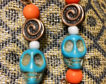 Turquoise and orange skull earrings