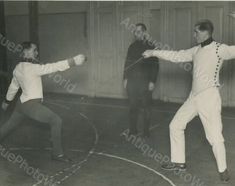 Two fancers in action antique fencing photo