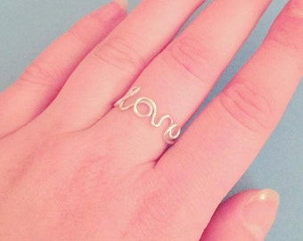 Wire wrapped LOVE ring cursive