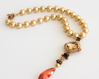 Gold Pearls Necklace with Beadwoven Pendant of Golden Swarovski Crystal and Magma Red Cubic Zirconia Stones and Dark Brown Crystals S144