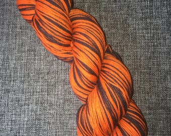 Wicked Pumpkin self striping sock yarn merino nylon hand dyed skein