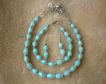 Turquoise handblown 3 peice boro glass jewelry set.