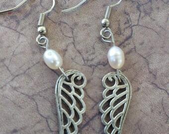 Silver tone wings earrings bird pearl beads