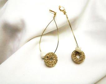 Ηandmade bronze earrings with round golden knitted pearls