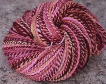 "Handspun Yarn, Merino Wool - Worsted Weight – ""Love Potion"" with Peach, Cabernet, Purple, Pink, and Cream / 100 yards each"