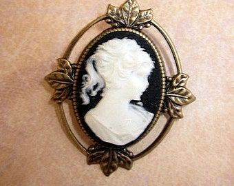 Classic black and white cameo pin