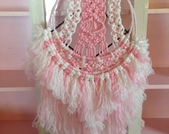 white and pink macrame wall hanging