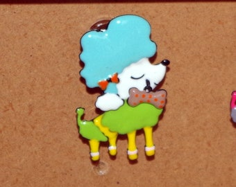buttons on chest of drawers or drawers dog (poodle)