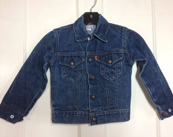 1970's kid's Levi's jean Jacket 2 pocket with snaps looks size small orange tab made in USA dark wash
