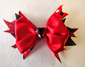 Red Layered Spike Bow, pinwheel holiday hairbow, Red satin christmas bow with rhinestone. Glitter holiday hairbow.