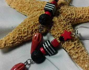 Rustic and passionate earrings. Red and black beads Earth lava star