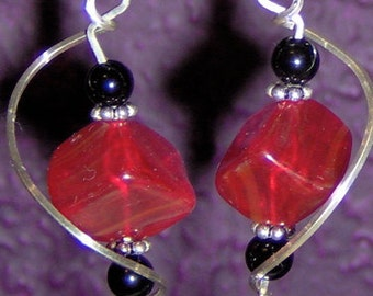Red dice earrings with black accents and silver twist