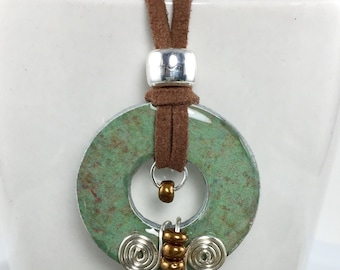 Green necklace, soft faux leather cording, non tarnishing silver wire detail, beautiful brown glass beads.