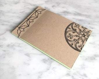 HANDMADE NOTEBOOK A6, Japanese stab-bound with black cotton, 40 blank green pages, craft card cover, medieval printed circular pattern