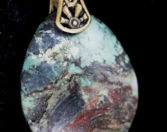 Vintage Turquoise pendant, brass sunrays bail 40ct