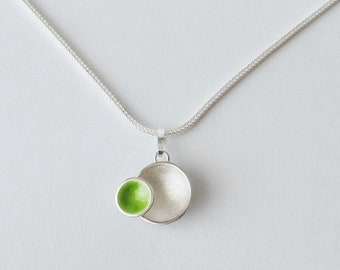 Asymmetric pendant made of sterling silver and green enamel
