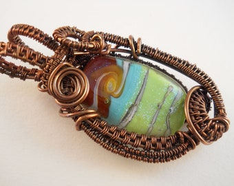 Copper woven & wrapped pale green and tan swirl with dichroic sparkles tabular lampwork bead pendant