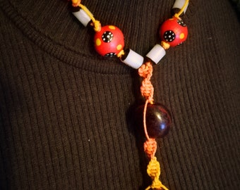 The 'Earth-Sun' necklace, hemp, Buri Nut, Sebuca Seeds, Wood.
