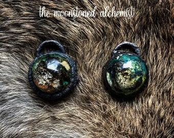 Nature blob amulets infused with real moss, lichen, and bark immortalized and set in dark copper