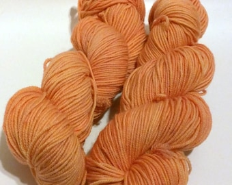 Kumquat on Octosport  SW Merino Hand dyed Sport weight  yarn