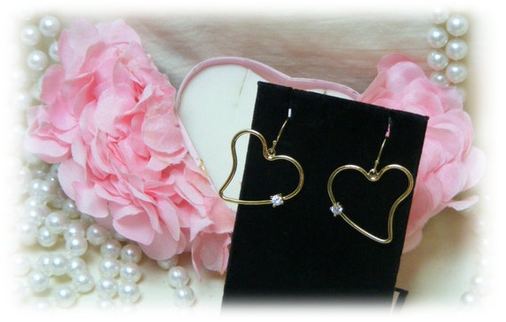 HEART DANGLE EARRINGS with rhinestones in an adorable pink box.