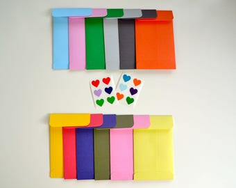 12 small envelopes, different colours