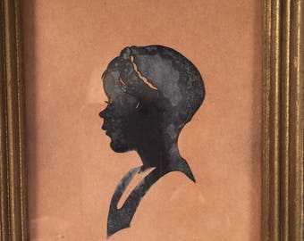Silhouette of a young girl Most likely from the mid to late 1800's - cut paper