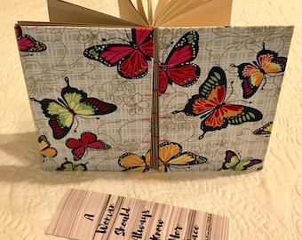Coptic stitch journal with butterfly fabric cover