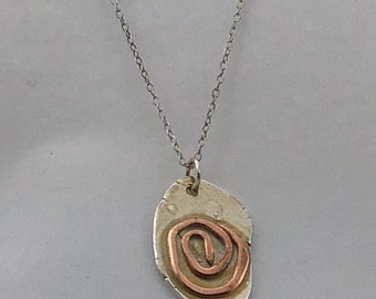 Abstract, organic silver pendant with spiral copper design on 18inch silver trace chain