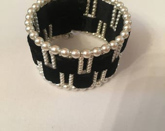 Faux Pearl with black velvet ribbon Cuff bracelet with opening.