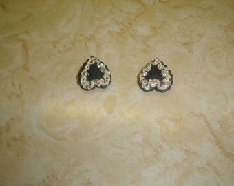 vintage clip on earrings black lucite heart pink glitter flowers