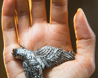 A bird in the hand - sterling silver/brass necklace