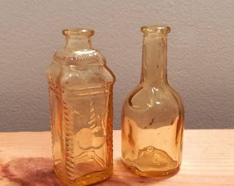Two vintage Yellow Amber Glass Wheaton Bottles, Phila Berring's Apple Ginger and Rogers Brothers 1850 Seal