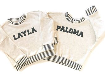Customize it! A personalized sweatshirt with your child's name professionally applied to front.