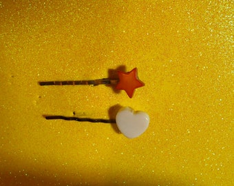 Two (2)  flat back barrettes, one white heart and one burnt orange star  #1071