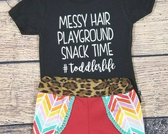 Toddler life outfit- rainbow shorts- leopard shorts- coachella shorts- messy hair shirt- toddler life shirt- toddler summer outfit- rainbow