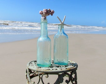 Set of Two Vintage Antique Aqua Bottles with Starfish and Barnacles
