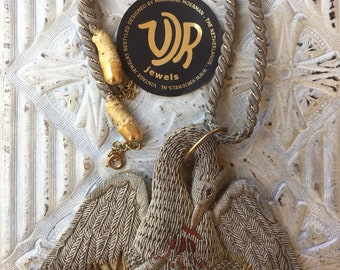Chain of 19th century handembroidered swan ornament to old cord