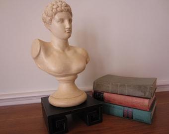 Statuesque Greek ceramic bust on black greek key base.