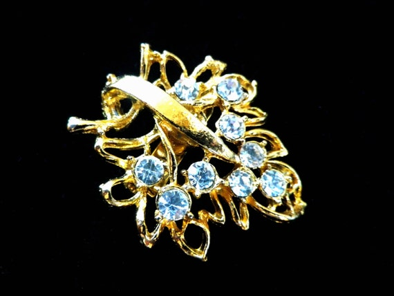 Small gold tone leaf shaped brooch with rhinestones in gift box